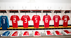 NEWPORT, WALES - Tuesday, October 16, 2018: The shirts of Owen Evans, Aaron Lewis, Rhys Norrington Davies, Cian Harries, Regan Poole, Joseff Morrell and Thomas Harris hang in the dressing room ahead of the UEFA Under-21 Championship Italy 2019 Qualifying Group B match between Wales and Switzerland at Rodney Parade. (Pic by Laura Malkin/Propaganda)