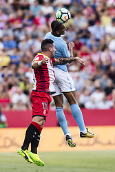 August 15, 2017 - Girona, Spain - 07 Raheem Sterling from England of Manchester City defended by 11 Aday from Spain of Girona FC during the Costa Brava Trophy match between Girona FC and Manchester City at Estadi de Montilivi on August 15, 2017 in Girona, Spain. (Credit Image: © Xavier Bonilla/NurPhoto via ZUMA Press)