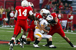 10 September 2011: Ben Ericksen and Josh Howe wrap up Zach Lewis during an NCAA football game between the Morehead State Eagles and the Illinois State Redbirds at Hancock Stadium in Normal Illinois.