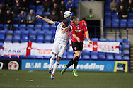Tranmere Rovers' Ryan Lowe and Oldham Athletic's  David Mellor jump for the ball. Skybet football league 1match, Tranmere Rovers v Oldham Athletic at Prenton Park in Birkenhead, England on Saturday 1st March 2014.<br /> pic by Chris Stading, Andrew Orchard sports photography.