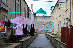 Terraced housing next to a mosque, Keighley, West Yorkshire