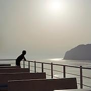Passenger on board a ferry overlooking Salina, Aeolian Islands, Italy