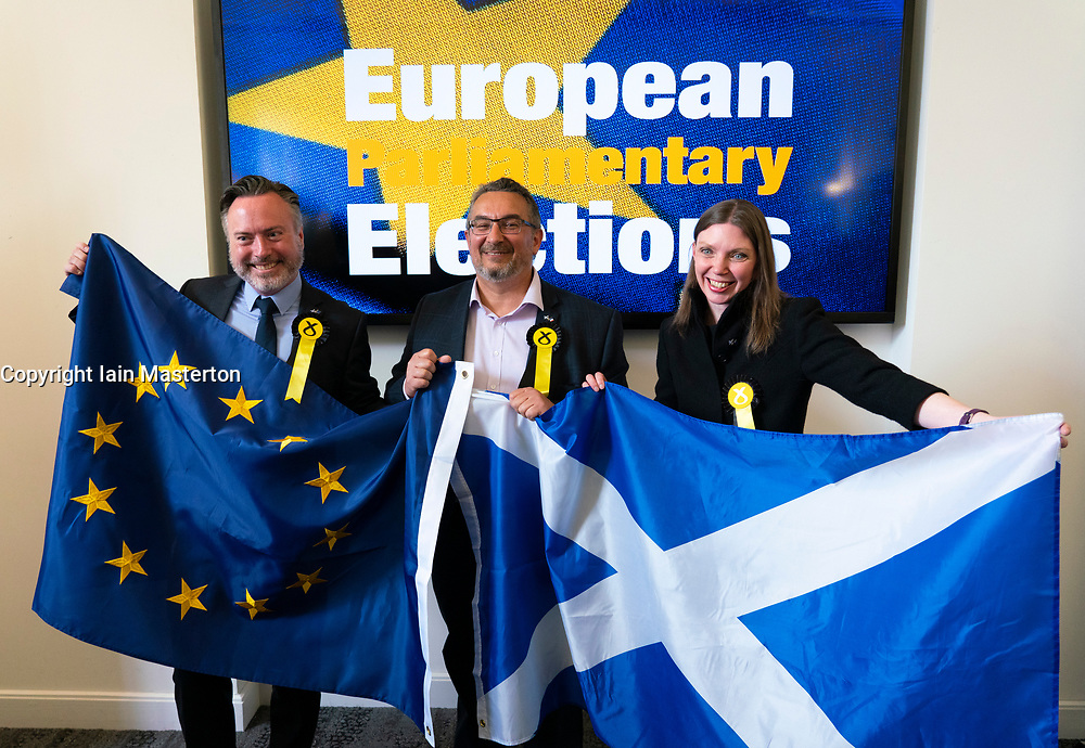 Edinburgh, Scotland, UK. 27 May, 2019. The six new Scottish MEPs are declared at the City Chambers in Edinburgh, SNP's Alyn Smith, Christian Allard and Aileen McLeod, Louis Stedman-Bruce from the Brexit Party, Sheila Ritchie of the Liberal Democrats and Baroness Nosheena Mobarik of the Conservatives. Pictured The three new SNP MEPs, l to r,  Alyn Smith, Christian Allard and Aileen McLeod