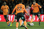 Brentford forward Ollie Watkins (11) battles for possession with Barnet midfielder Dan Sweeney (26) during The FA Cup fourth round match between Barnet and Brentford at The Hive Stadium, London, England on 28 January 2019.