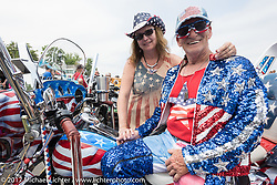 "Lance Blais was never able to ride a two-wheeler after being shot down in Vietnam as a Medivac pilot so after he recovered enough, his father and brother helped him build his first trike. After a number of trikes, he comes to Laconia every year as the ""All American Handyman on his patriotically painted Tri-Glide. Since the police didn't take kindly to Lance shooting out confetti from his two handlebar mounted cannons, he decided to load them with one-hundred $100 bills and guess what, there was no litter left behind! Laconia Motorcycle Week, New Hampshire, USA. Saturday June 17, 2017. Photography ©2017 Michael Lichter."