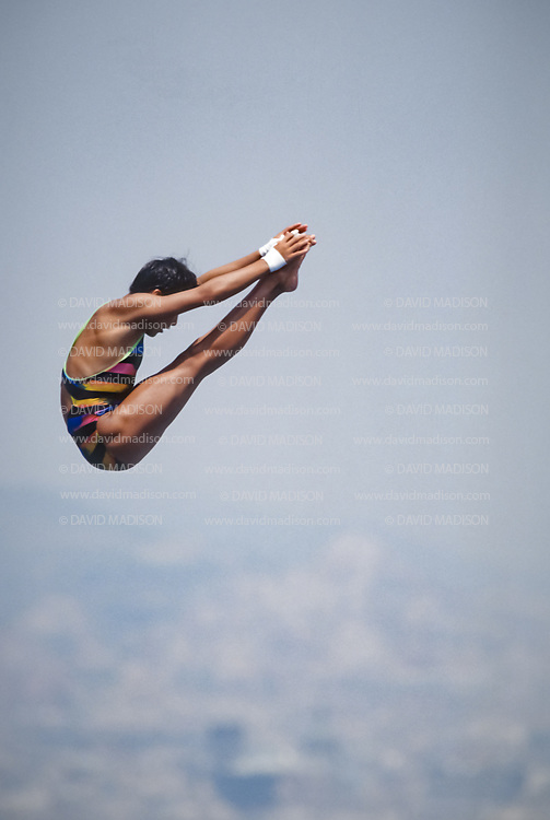 BARCELONA - JULY 27:  Fu Mingxia of China, the eventual gold medalist, competes in the Women's 10 meter Diving final at the Piscina Municipal de Montjuic on July 27, 1992 during the Summer Olympics in Barcelona, Spain.  (Photo by David Madison/Getty Images)
