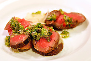 An appetizer, Crostini with Marin Sun Farms beef filet, cranberry bean puree, and celery leaf salsa verde, sits in the kitchen before being served to a guest at Zuni Cafe on Market Street in San Francisco, CA., on Tuesday, Oct. 23, 2007. ..PHOTOGRAPHER: Erin Lubin/Bloomberg News.