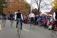 Bicycle Rider at the Children's Parade at Keene Pumpkin Festival
