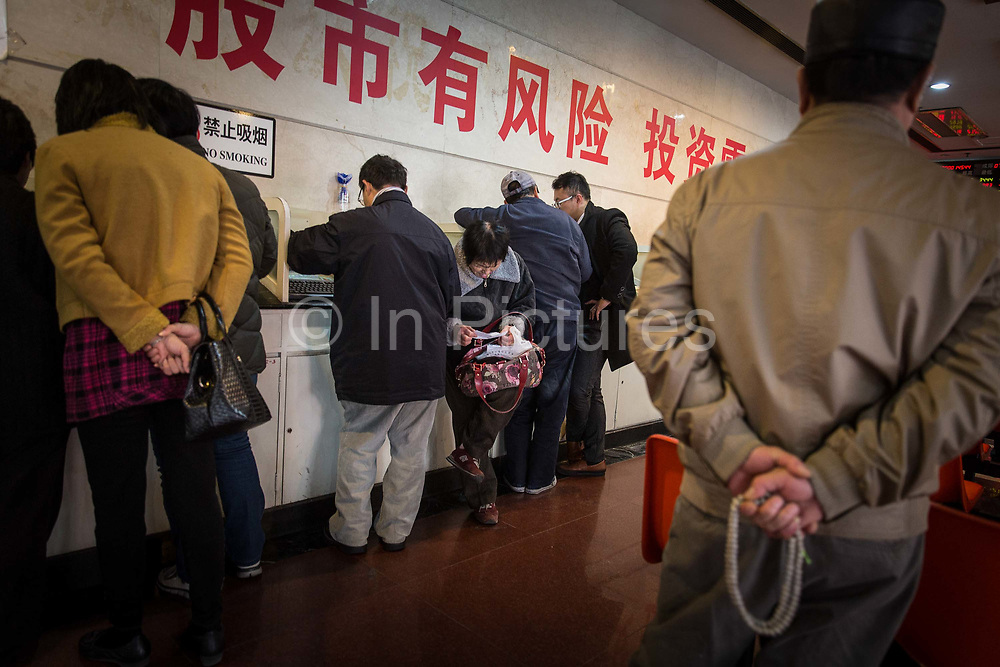 Small retail investors gather and trade stocks at a security brokerage house in Shanghai, China on 09 December 2014.