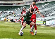 Plymouth Argyle Midfielder Joe Edwards (8) shields the ball and hold off Sunderland Forward Jordan Jones (27)  during the EFL Sky Bet League 1 match between Plymouth Argyle and Sunderland at Home Park, Plymouth, England on 1 May 2021.