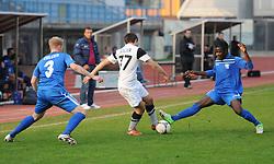 Mbida Bindzi Ebila Jean #14 of ND Gorica vs. Mario Sacer #77 of ND Mura 05 during football match between ND Gorica and ND Mura 05 in 20th Round of PrvaLiga NZS 2012/13 on November 24, 2012 in Nova Gorica, Slovenia. (Photo By Ales Cipot / Sportida)