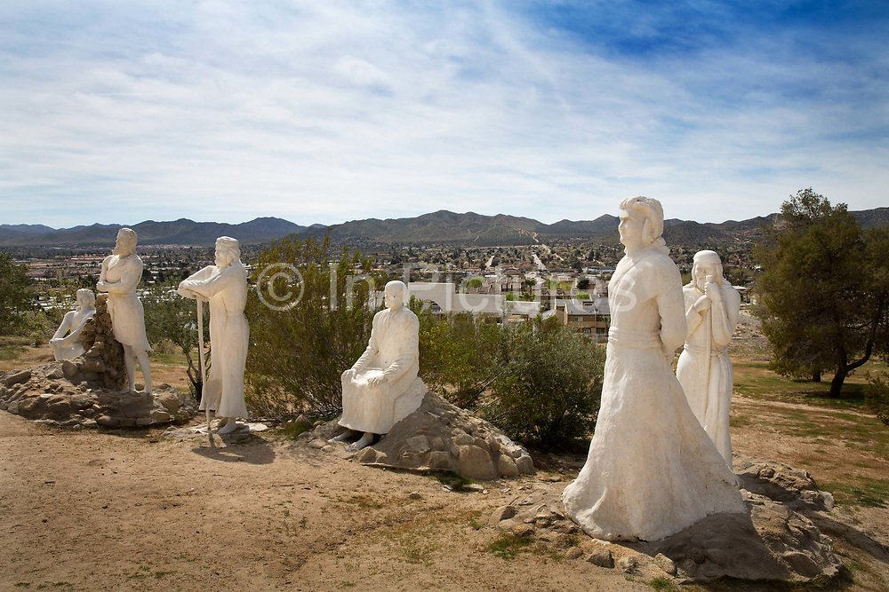 Starting in the 1950s, sculptor Antone Martin fashioned concrete into over 35 Biblical figures. Despite the apparent theme, he created the park as his personal statement of peace rather than religious devotion. Statues dot the hillside above the Evangelical Free Church. There are groupings of disciples listening to the Sermon on the Mount, apostles and other biblical characters in discussion or contemplation. The bright alabaster sculptures of followers tend to face away from the sun, while the Messiah faces the bustling town of Yucca Valley.