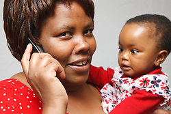 Mother on mobile phone with daughter.