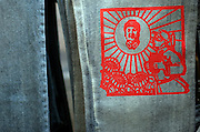 Beijing, China November 18, 2004 - A detail on a pair of jeans by Chinese fashion designer Feng Ling. The red picture is meant to look like a traditional paper cutting, and depicts chairman Mao Zedong in the center of the sun, a popular motif during the cultural revolution.  Photo by Natalie Behring