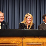 George Diller (L), SpaceX President Gwynne Shotwell and COTS manager Alan Lindenmoyer (R) discuss the Falcon 9 rocket test launch delay at Cape Canaveral's Complex 40 launch pad after cracks were discovered on a nozzle on December 6, 2010 at Cape Canaveral, Florida. (AP Photo/Alex Menendez)