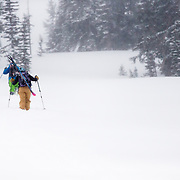 Heather Goodrich and Tanner Flanagan hike towards the goods in the Teton backcountry near Jackson Hole Mountain Resort.