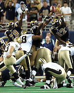 New Orleans kickr John Carney (3) sends the game into overtime as he kicks a 38-yard field goal to tie the game with the St. Louis Rams 25-25.  The Saints beat the Rams 28-25 in St. Louis, Missouri, Sept. 26, 2004.