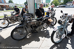 Peter Reeves of the UK, BIll Rodencal of WI, Paul Jung of Germany, and father and son Thomas and Eric Trapp of Germany gas up their Harley-Davidson Motorcycles during the Motorcycle Cannonball Race of the Century. Stage-4 from Chillicothe, OH to Bloomington, IN. USA. Tuesday September 13, 2016. Photography ©2016 Michael Lichter.