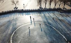 January 2, 2018 - Shenyang, China - People enjoy skating on the frozen lake at a park in Shenyang, northeast China's Liaoning Province. (Credit Image: © SIPA Asia via ZUMA Wire)
