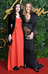 Elizabeth Jagger (left) and Jerry Hall attending the Fashion Awards in association with Swarovski held at the Royal Albert Hall, Kensington Gore, London