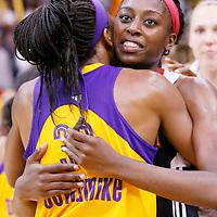 03 August 2014: Los Angeles Sparks forward Nneka Ogwumike (30) hugs her sister Connecticut Sun forward Chiney Ogwumike (13) during the Los Angeles Sparks 70-69 victory over the Connecticut Sun, at the Staples Center, Los Angeles, California, USA.
