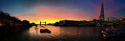 © Licensed to London News Pictures. 25/01/2016. London, UK. A composite mobile phone panorama of colourful sky behind Tower Bridge and the London Shard on the River Thames  just ahead of sunrise and mild weather this morning.  Photo credit : Vickie Flores/LNP