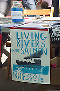 Protest sign reads Living Rivers Have Salmon - No Coal Barges at a 2015 May Day rally in Portland, Oregon.