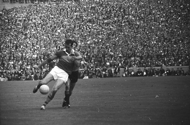 Kerry forward gets in his kick as Down tries to attack during the All Ireland Senior Gaelic Football Final Kerry v Down in Croke Park on the 22nd September 1968. Down 2-12 Kerry 1-13.