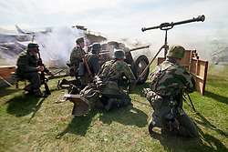 Reenactors of the NWW2A Portraying members of the 21st Panzer Division fire a replica PAK anti-tank gun during a 1940s wartime weekend at Fort Paull on Bank Holiday Monday ..5 May 2013.Image © Paul David Drabble
