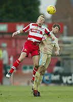 Photo: Aidan Ellis.<br /> Doncaster Rovers v Bristol City. Coca Cola League 1.<br /> 26/11/2005.<br /> Doncaster's Ricky Ravenhill beats Bristol's Cole Skuse