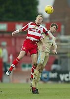Photo: Aidan Ellis.<br /> Doncaster Rovers v Bristol City. Coca Cola League 1.<br /> 26/11/2005.<br /> Doncaster's Ricky Ravenhill beats Bristol's Cole Skuse