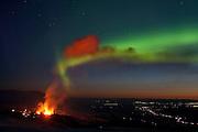 Aurora Borealis in the sky behind the erupting volcano in Fimmvörðuháls, south Iceland 2010