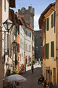 The Fortress at Montalcino stands tall at the end of a narrow shopping street, in Tuscany, Italy