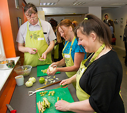 Pictured: Alan Fisher, Laura Munro and Pam Hickey get stuck in preparing some rhubarb.<br /> Public Health Minister Aileen Campbell joined a class at the Pilton Community Health Project which helps families gain confidence in the kitchen, ahead of the Scottish Government's consultation on its diet and obesity strategy being launched in the autumn<br /> Ger Harley | EEm 10 August  2017