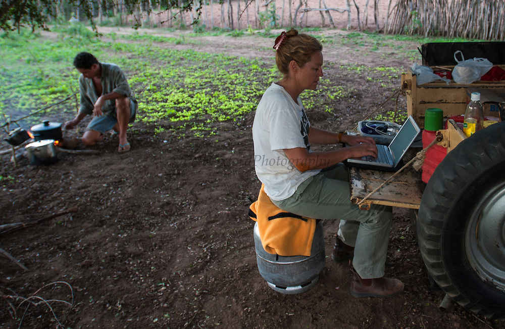 Reneé Bish working on Computer<br /> Using Jeep as Desk<br /> Caatinga. NE BRAZIL.  South America<br /> While photographing Lear's Macaws