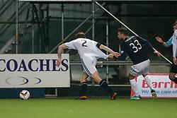 Raith Rovers Jason Thomson held by Falkirk's Rory Loy.<br /> Falkirk 3 v 1 Raith Rovers, Scottish Championship game at The Falkirk Stadium.