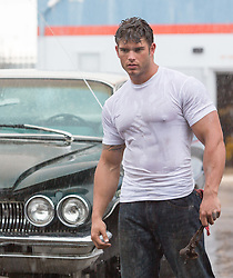 hunky auto mechanic in the rain
