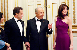 SHIMON PERES (2 August 1923 - 28 September 2016) was a Polish-born Israeli statesman. Born Szymon Perski, he was the ninth President of Israel from 2007 to 2014, served twice as the Prime Minister of Israel and twice as Interim Prime Minister, and he was a member of 12 cabinets in a political career spanning over 66 years. Peres won the 1994 Nobel Peace Prize together with Yitzhak Rabin and Yasser Arafat for the peace talks that he participated in as Israeli Foreign Minister, producing the Oslo Accords. PICTURED: Mar 10, 2008 - Paris, France - France's President NICOLAS SARKOZY and his wife CARLA BRUNI SARKOZY receive at a state dinner for Israel's President SHIMON PERES the Elysee Palace. (Credit Image: © Visual/ZUMA Press)