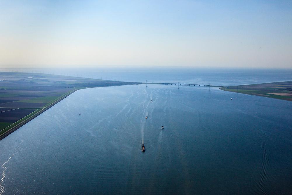 Nederland, Flevoland, Ketelmeer, 01-05-2013; scheepvaart op het Ketelmeer, gezien naar de Ketelbrug (A6) en IJsselmeer.<br /> Ships sail on the Ketelmeer (Ketel Lake), in the back IJsselmeer. <br /> luchtfoto (toeslag op standard tarieven)<br /> aerial photo (additional fee required)<br /> copyright foto/photo Siebe Swart