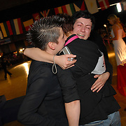 Tania Dimitrova, right, hugs Claudia Neidig, left, and her dance partner, Kristin Marunke, all of Berlin, Germany, after Neidig and Marunke won the gold medal in the women's standard C division of the same-sex ballroom dancing competition during the 2007 Eurogames at the Waagnatie hangar in Antwerp, Belgium on July 14, 2007. ..Dimitrova is Marunke's latin dance partner. ..Over 3,000 LGBT athletes competed in 11 sports, including same-sex dance, during the 11th annual European gay sporting event. Same-sex ballroom is a growing sports that has been happening in Europe for over two decades.