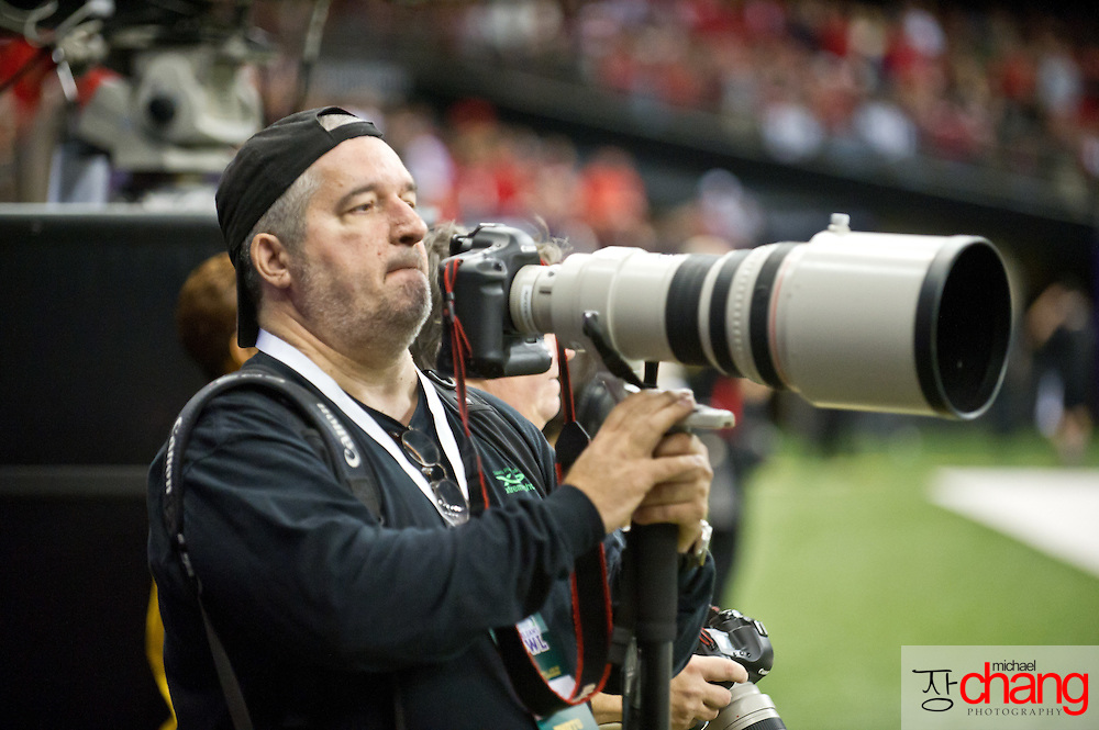 Mississippi based sports photographer, Bobby McDuffie during the R+L Carriers New Orleans Bowl at the Mercedes-Benz Superdome.  Louisiana-Lafayette defeated San-Diego State 32-30. (Copyright Michael Chang)