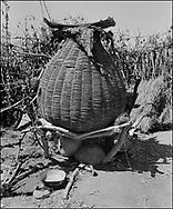 Karamajong; karimajong; tribal; Africa; Uganda; Photo art; wall art; reportage; photo; black and white; 1980; fruit; harvest; sun drird; grain bins;
