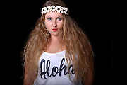 Young female teen with long blond hair and a wreath of flowers on her head. Model released