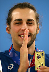 Italy's Gianmarco Tamberi with his gold medel for the Men's High Jump during day two of the European Indoor Athletics Championships at the Emirates Arena, Glasgow.