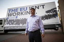 """© Licensed to London News Pictures . 25/09/2015 . Doncaster , UK . AARON BANKS in front of an ad trailer with """" The EU isn't working """" at the 2015 UKIP Party Conference at Doncaster Racecourse , this morning (Friday 25th September 2015) . Photo credit : Joel Goodman/LNP"""
