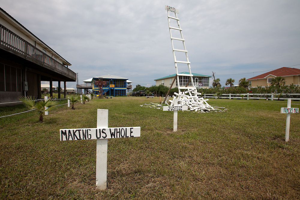 Mock graveyard on Grand Isle that has change from many crosses signifying all things lost to a simple message about greed for Labor Day Weekend.  The long-term economic and environmental impact of the BP oil spill, the largest in American History,  have yet to be assessed.