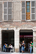 Locals having lunch in cafe delicateen La Gourmandise in the city of Pau, France