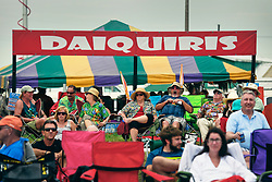 02 May 2014. New Orleans, Louisiana.<br /> Festival goers at the  New Orleans Jazz and Heritage Festival. <br /> Photo; Charlie Varley/varleypix.com
