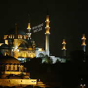 """Night View of the Suleymaniye Mosque with special lighting decorated with writing known as mahya for month of Ramadan which is the holly fasting  season for the Muslims. The writing between the minarets reads as """"Sulten of the Eleven Month"""". The Holly month of ramadan has started on Saturday night in Turkey for the Islam beliewers.  Saturday, 23.09.2006<br /> Photo by Ahmet DUMANLI/TURKPIX"""
