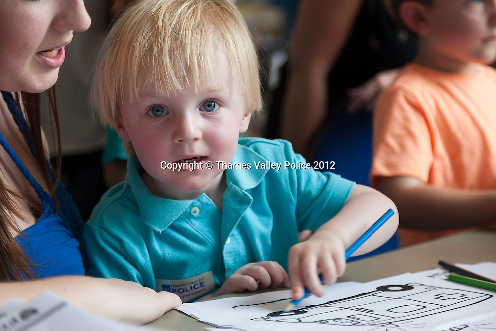 Alfie Bateman, helped by mum Claire, enjoys some of the colouring sheets available at the Family Events Police Day held at Oxford Brookes University by Thames Valley Police. Oxford, UNITED KINGDOM. August 18 2012. <br /> Photo Credit: MDOC/Thames Valley Police<br /> © Thames Valley Police 2012. All Rights Reserved. See instructions.